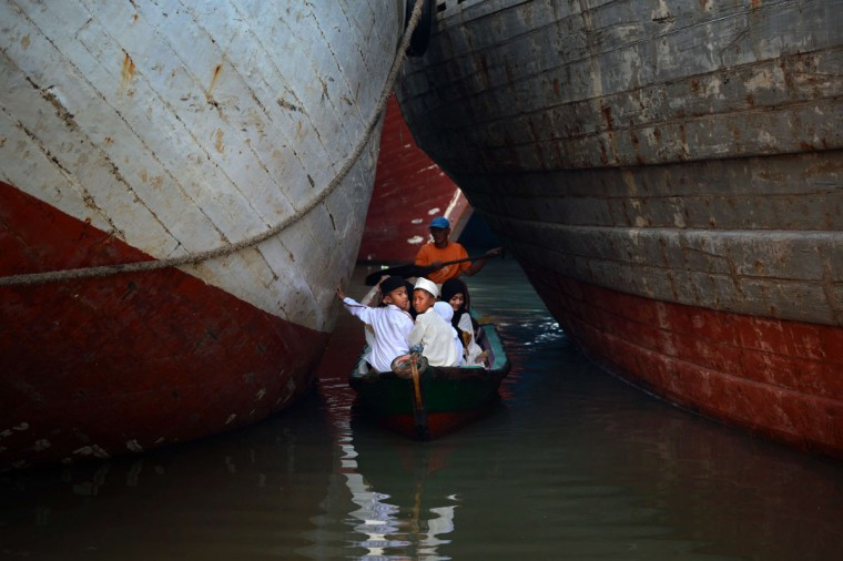 Indonesian Muslim devotees arrive on a boat to attend the morning prayer to celebrate the Eid al-Fitr festival at the historic Sunda Kelapa port district of Jakarta on July 28, 2014. Muslims around the world are celebrating Eid al-Fitr which marks the end of the month of Ramadan, after the sighting of the new crescent moon. (Romeo Gacad/AFP/Getty Images)