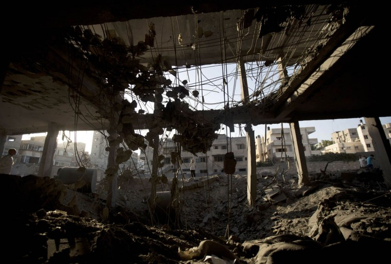 """A general view shows destruction inside a mosque in Gaza City, on July 30 2014 after it was hit in an overnight Israeli strike. Israeli bombardments killed """"dozens"""" of Palestinians in Gaza, including at least 16 at a UN school, medics said, on day 23 of the Israel-Hamas conflict. (Mahmud Hams/Getty Images)"""