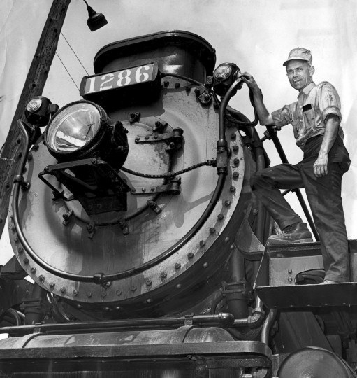 August 5, 1965 George Hart stands on a steam locomotive that he owns in York Pennsylvania. (William L. LaForce, Jr./Baltimore Sun)