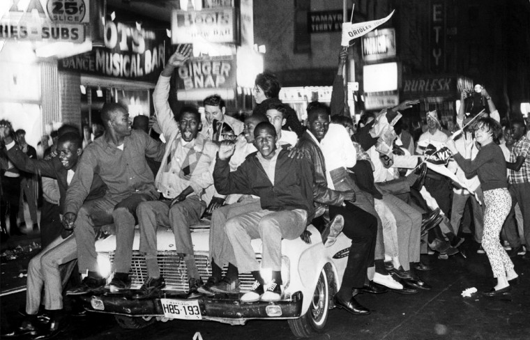 In October of 1966 jubilant Oriole fans on Baltimore Street celebrate after the Orioles won their 4th straight game to win the 1966 World Series. (William L. LaForce, Jr./Baltimore Sun)