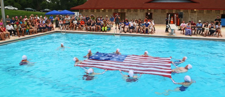 """Fluid Movement performed a water ballet on July 24, 2014 at Druid Hill Park. """"Star Spangled Swimmer: A War of 1812 Water Ballet"""" sold out its first night and drew a large crowd the following night. (Kaitlin Newman/Baltimore Sun)"""