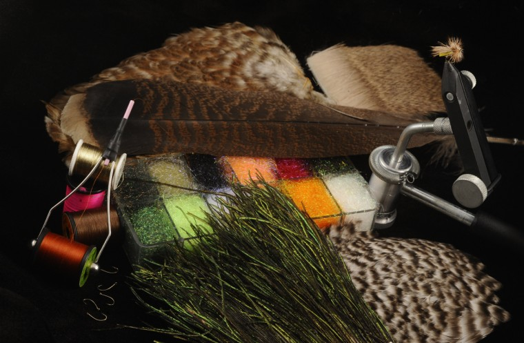 Pictured are fly-tying materials that include bird feathers, rabbit skin, treads, synthetic dubbing, hooks, and vise. Flies, materials and equipments provided by Theaux Le Gardeur of Backwater Angler in Monkton. (Kenneth K. Lam/Baltimore Sun)