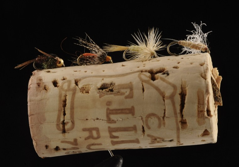 From left, flies representing the life cycles of the Sulphur mayfly: Pheasant tail nymph, Partridge & Yellow emerger, adult Sulphur Dun and Rusty Spinner. All are used for trout fishing. (Kenneth K. Lam/Baltimore Sun)
