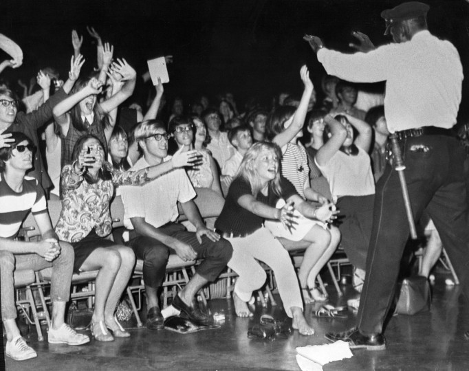 June 27, 1966 - The unseen cause of all this emotion was the Rolling Stones, whose rock and roll performance soon came to an abrupt halt when teen-agers charged the stage at the Civic Center. Police halted show attended by 5,000 but some 1,000 milled about outside later. There were no arrests or injuries. (William L. LaForce/Baltimore Sun)