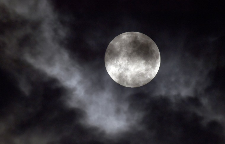Clouds pass in front of the Supermoon early on Saturday, July 12, 2014, in Olathe, Kan., as it nears its closest point to the earth, called perigee. (John Sleezer/Kansas City Star/MCT)