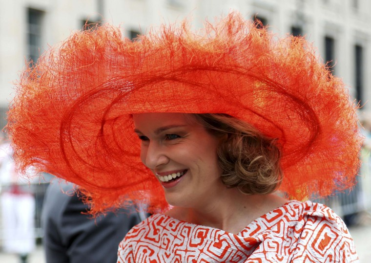 Belgium's Queen Mathilde smiles as she leaves a religious service (Te Deum) at the Sainte-Gudule cathedral in Brussels July 21, 2014. Belgium celebrates its National Day on Monday. (REUTERS/Francois Lenoir)
