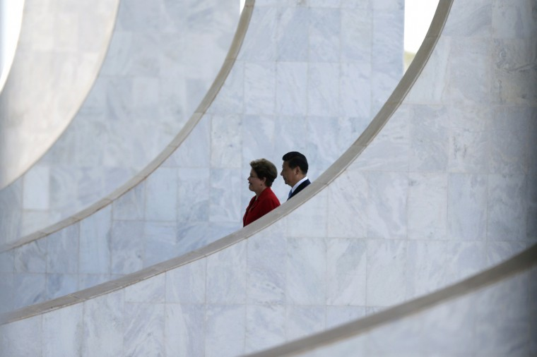 Brazil's President Dilma Rousseff (L) and China's President Xi Jinping arrive at the Planalto Palace before a meeting on the sidelines of the 6th BRICS summit in Brasilia July 17, 2014. (Ueslei Marcelino/Reuters)