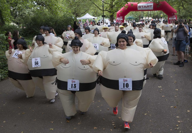 Participants take part in The Sumo Run in Battersea Park, London July 27, 2014. The runners, wearing inflatable costumes, take part in the 5km run with the aim of raising money for a charity to help educate children in Africa. (Neil Hall/Reuters)