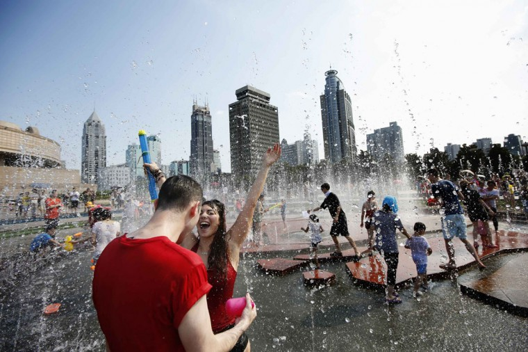 People participate in a water fight at People Square in Shanghai, July 20, 2014. (Aly Song/Reuters)