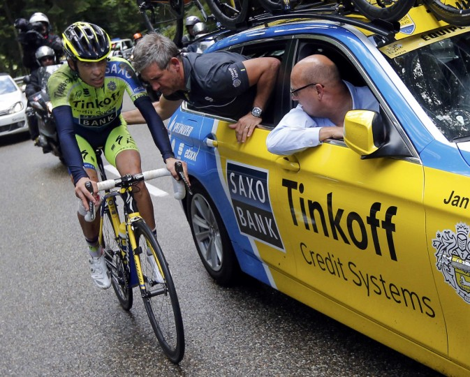 Tinkoff-Saxo team rider Alberto Contador of Spain gets mechanic assistance after he fell during the 161.5-km tenth stage of the Tour de France cycling race between Mulhouse and La Planche Des Belles Filles July 14, 2014. (Jean-Paul Pelissier/Reuters)
