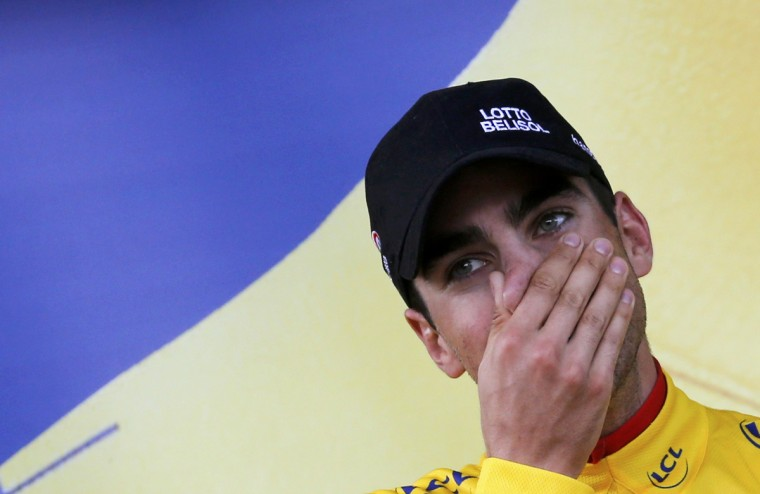 Lotto-Belisol team rider Tony Gallopin of France reacts on the podium as he took the leader's yellow jersey after the 170-km ninth stage of the Tour de France cycling race between Gerardmer and Mulhouse July 13, 2014. (Jean-Paul Pelissier/Reuters)