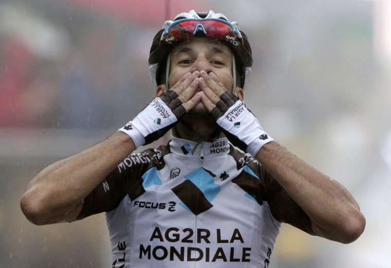 AG2R-La Mondiale team rider Blel Kadri of France celebrates as he crosses the finish line to win the 161-km (100 miles) eighth stage of the Tour de France cycling race between Tomblaine and Gerardmer La Mauselaine, July 12, 2014. (Jacky Naegelen/Reuters)