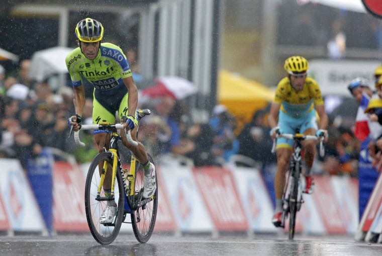 Tinkoff-Saxo team rider Alberto Contador of Spain climbs to the finish line ahead of Astana team rider Vincenzo Nibali of Italy during the 161-km (100 miles) eighth stage of the Tour de France cycling race between Tomblaine and Gerardmer La Mauselaine, July 12, 2014. (Jacky Naegelen/Reuters)