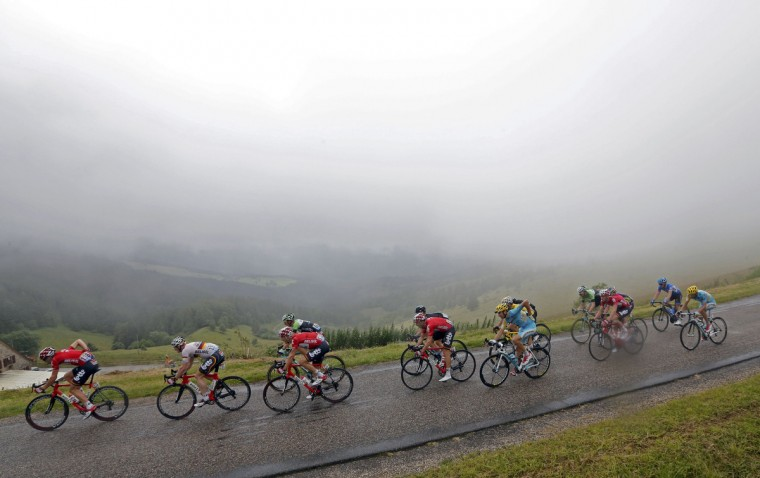 The pack of riders cycles on its way during the 161.5-km tenth stage of the Tour de France cycling race between Mulhouse and La Planche Des Belles Filles July 14, 2014. (Jean-Paul Pelissier/Reuters)