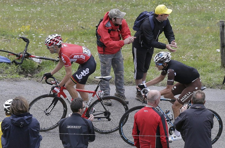 Lotto-Belisol team rider Tony Gallopin (L) of France cycles on its way to take the leader's yellow jersey during the 170-km ninth stage of the Tour de France cycling race between Gerardmer and Mulhouse July 13, 2014. (Jacky Naegelen/Reuters)