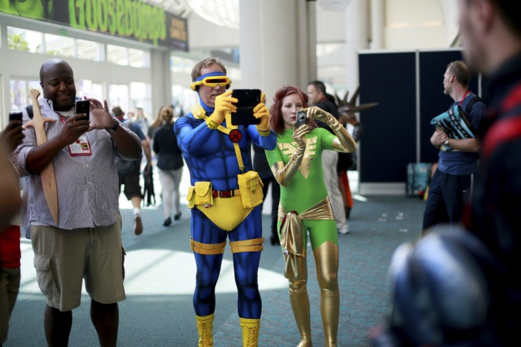 Costumed attendees take pictures during the 2014 Comic-Con International Convention in San Diego, California July 24, 2014. (Sandy Huffaker/Reuters)