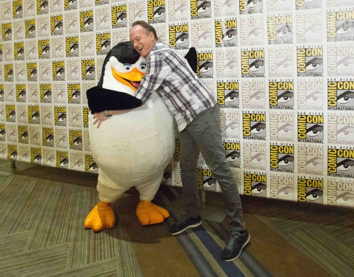 "Actor Tom McGrath, who voices ""Skipper"", poses with his character at a press line for the movie ""Penguins of Madagascar"" during the 2014 Comic-Con International Convention in San Diego, California July 24, 2014. (Mario Anzuoni/Reuters)"