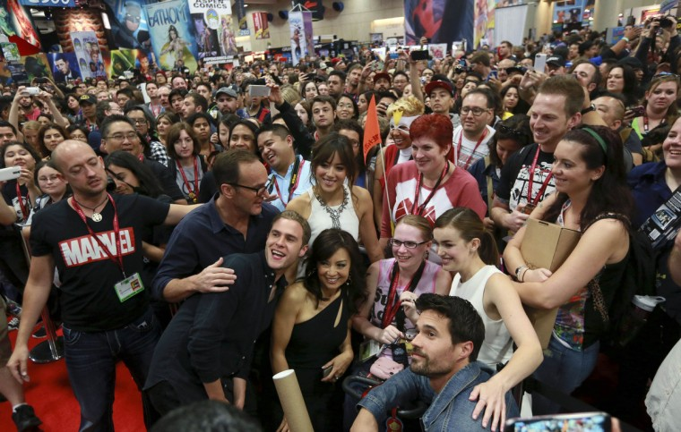"Cast members (bottom) have their photo taken with attendees during an autograph signing session for ""Marvel's Agent of S.H.I.E.L.D."" during the 2014 Comic-Con International Convention in San Diego, California July 26, 2014. (Sandy Huffaker/Reuters)"