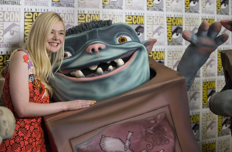 "Cast member Elle Fanning poses with a Boxtrolls character at a press line for ""The Boxtrolls"" during the 2014 Comic-Con International Convention in San Diego, California July 26, 2014. (Mario Anzuoni/Reuters)"