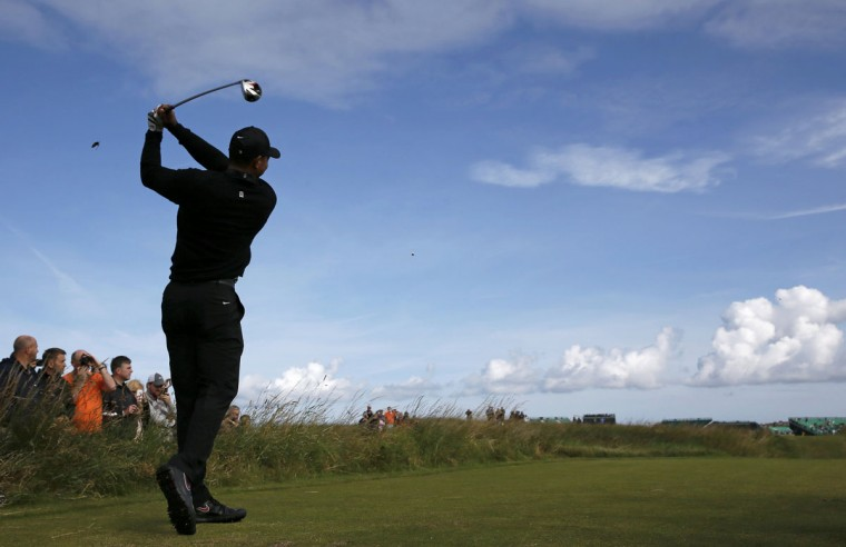 Tiger Woods of the U.S. watches his tee shot on the 12th hole during a practice round ahead of the British Open Championship at the Royal Liverpool Golf Club in Hoylake, northern England July 15, 2014. (REUTERS/Stefan Wermuth)