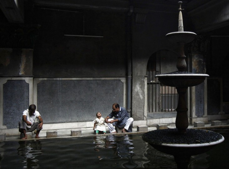 A Muslim man helps his son to perform ablution before offering evening prayers, during the holy fasting month of Ramadan at a mosque in Kolkata July 20, 2014. (Rupak De Chowdhuri/Reuters)