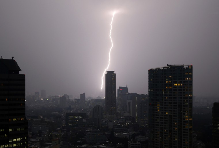 A bolt of lightning strikes over Tokyo skyscrapers at dusk in Tokyo July 24, 2014. (Issei Kato/Reuters)