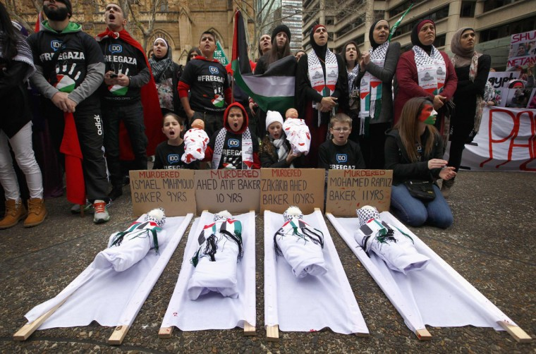 Children sit in front of dolls on stretchers as they and other members of the Australian Palestinian community hold a protest against Israel's military action in Gaza, in Sydney July 20, 2014. Israel said on Sunday it had expanded its ground offensive in Gaza and militants kept up rocket fire into the Jewish state with no sign of a diplomatic breakthrough to end the worst fighting between Israel and Hamas in two years. (David Gray/Reuters)