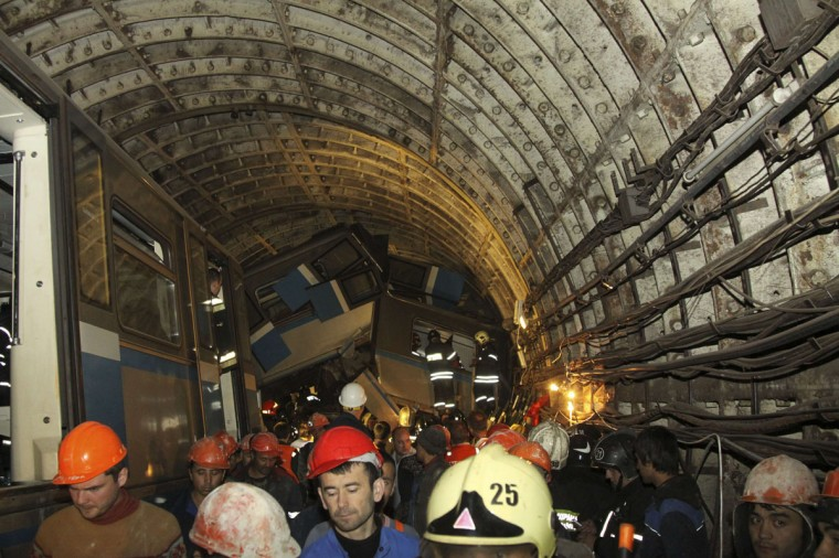 Members of the emergency services work at the site of an accident on the subway in Moscow July 15, 2014. At least 20 people were killed and more than 120 were injured when a Moscow underground train derailed during the morning rush hour in one of the worst accidents on the Russian capital's subway system in years. (REUTERS/Press Service of Russian Emergencies Ministry of Moscow Region/Handout via Reuters)