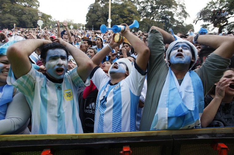 Argentina's fans watch a broadcast of the 2014 World Cup final soccer match in Brazil, between Germany and Argentina at a public square viewing area in Buenos Aires, July 13, 2014. (Martin Acosta/Reuters)