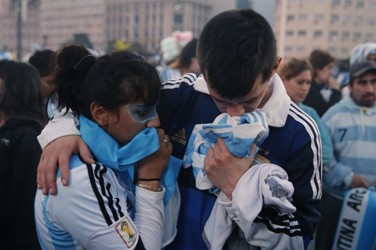 Argentina's fans react after Argentina lost to Germany in their 2014 World Cup final soccer match in Brazil, at a public square viewing area in Buenos Aires, July 13 2014. (Andres Stapff/Reuters)