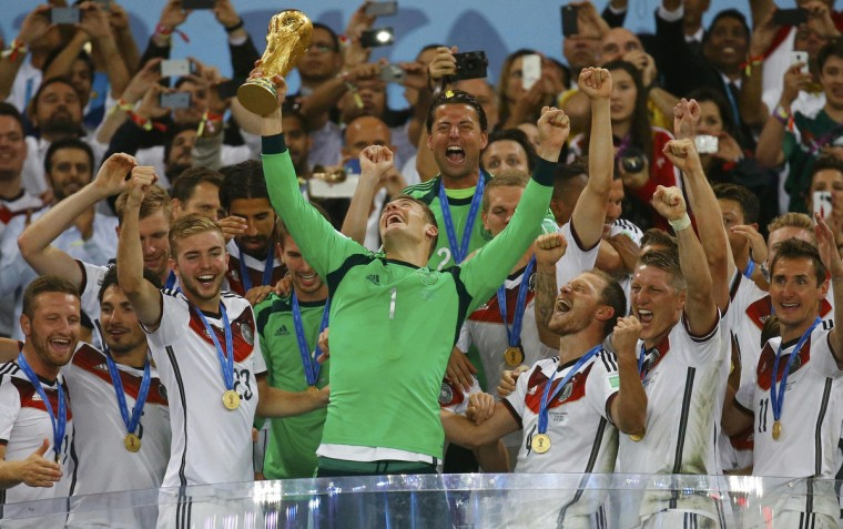 Germany's goalkeeper Manuel Neuer lifts the Golden Glove after being named as the best goalkeeper at the end of the 2014 World Cup final between Germany and Argentina at the Maracana stadium in Rio de Janeiro July 13, 2014. (Kai Pfaffenbach/Reuters)
