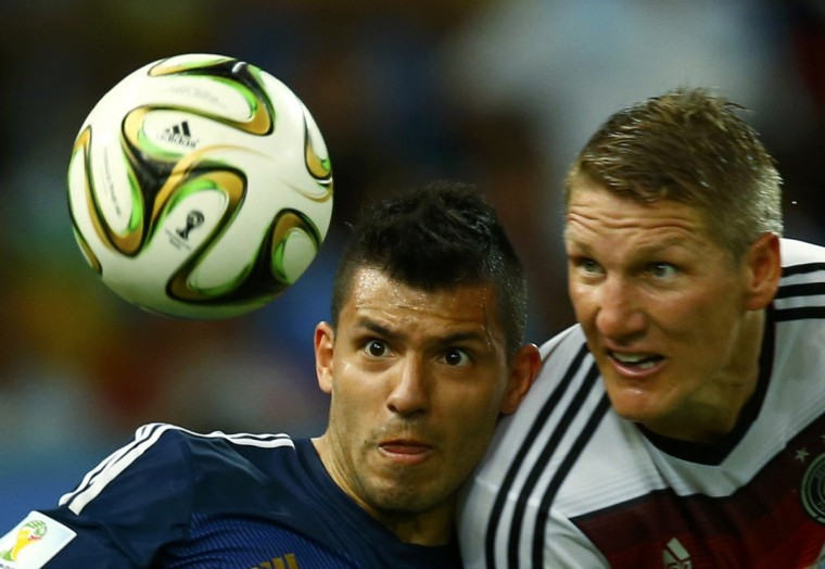 Argentina's Sergio Aguero jumps for the ball with Germany's Bastian Schweinsteiger during their 2014 World Cup final at the Maracana stadium in Rio de Janeiro July 13, 2014. (Eddie Keogh/Reuters)