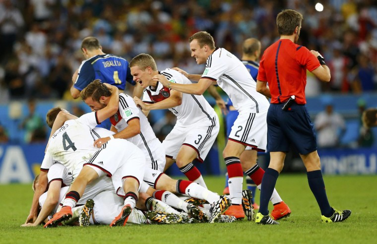 Germany players celebrate after extra time in the 2014 World Cup final between Germany and Argentina at the Maracana stadium in Rio de Janeiro July 13, 2014. (Darren Staples/Reuters)