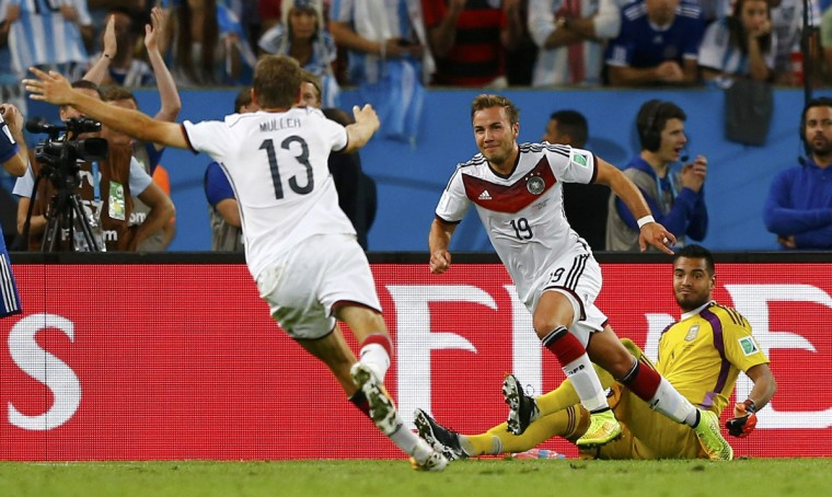 Germany's Mario Goetze celebrates with Thomas Mueller after scoring a goal during the 2014 World Cup final between Germany and Argentina at the Maracana stadium in Rio de Janeiro July 13, 2014. (Darren Staples/Reuters)