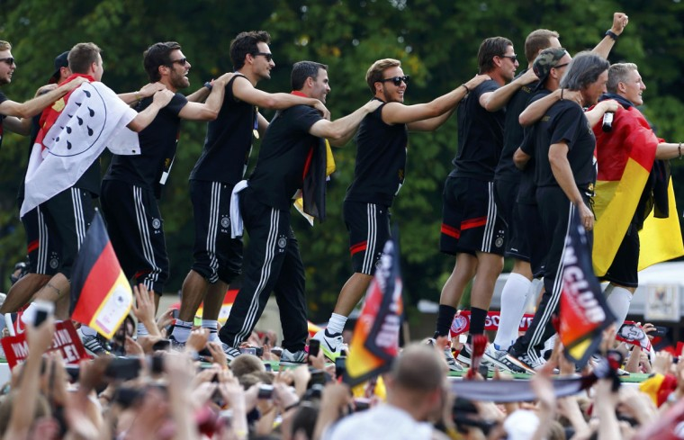 Members of Germany's 2014 Brazil World Cup squad appear on stage during celebrations to mark the team's 2014 Brazil World Cup victory, at a 'fan mile' public viewing zone in Berlin July 15, 2014. Germany's victorious soccer team led by coach Joachim Loew returned home on Tuesday after winning the 2014 Brazil World Cup. A triumphant Germany team landed in Berlin on Tuesday to a hero's welcome, greeted by hundreds of thousands of jubilant Germans waving flags and wearing the national colours, revelling in the nation's fourth World Cup victory on Sunday in Brazil. (REUTERS/Thomas Peter)