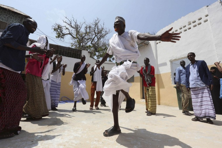 A man performs a traditional dance in celebration after attending Eid al-Fitr prayers to mark the end of the fasting month of Ramadan in Somalia's capital Mogadishu, July 28, 2014. (Feisal Omar/Reuters)