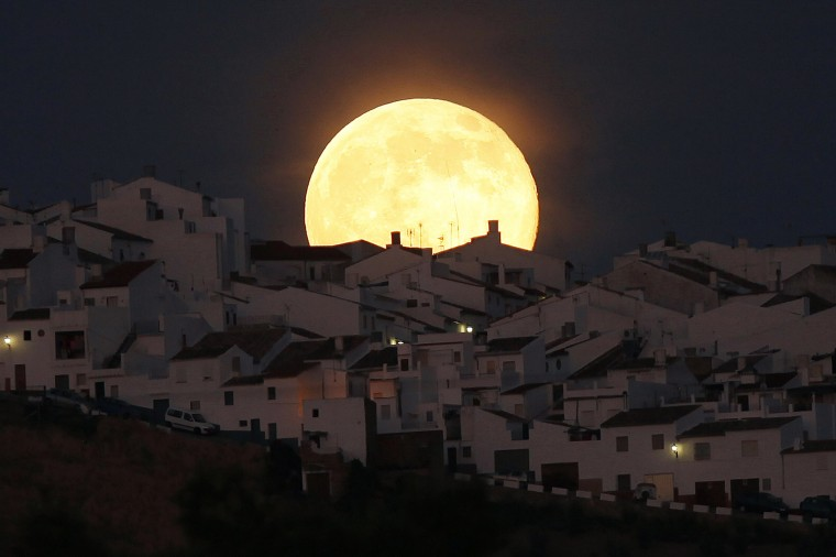 The Supermoon rises over houses in Olvera, in the southern Spanish province of Cadiz, July 12, 2014. Occurring when a full moon or new moon coincides with the closest approach the moon makes to the Earth, the Supermoon results in a larger-than-usual appearance of the lunar disk. REUTERS/Jon Nazca