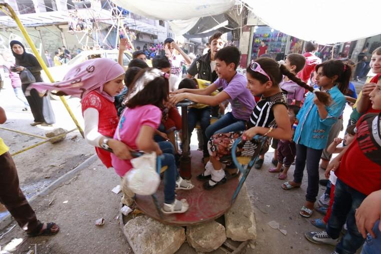 Children play in Aleppo July 30, 2014. Picture taken July 30, 2014. REUTERS/Nour Kelze