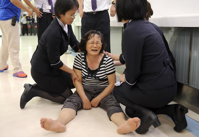 A relative of a passenger on board the crashed TransAsia Airways plane cries in Kaohsiung International Airport, southern Taiwan, July 23, 2014. A TransAsia Airways turboprop ATR-72 plane crashed on its second attempt at landing during a thunderstorm on Penghu, an island off Taiwan on Wednesday, killing 47 people and setting buildings on fire, officials said. (Reuters)