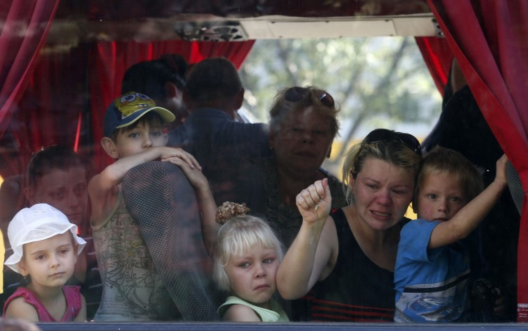 Residents of the eastern Ukrainian region of Donetsk look out of a bus window as they prepare to depart for Russia to escape the fighting between the Ukrainian army and pro-Russian rebels at a collection point in Donetsk. (Maxim Zmeyev/Reuters)