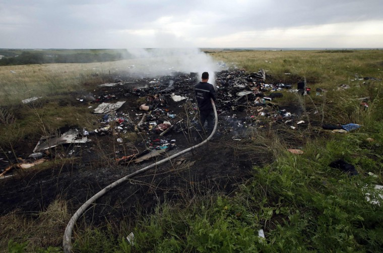 An Emergencies Ministry member works at putting out a fire at the site of a Malaysia Airlines Boeing 777 plane crash in the settlement of Grabovo in the Donetsk region, July 17, 2014. The Malaysian airliner MH-17 was brought down over eastern Ukraine on Thursday, killing all 295 people aboard and sharply raising stakes in a conflict between Kiev and pro-Moscow rebels in which Russia and the West back opposing sides. (Maxim Zmeyev/Reuters)