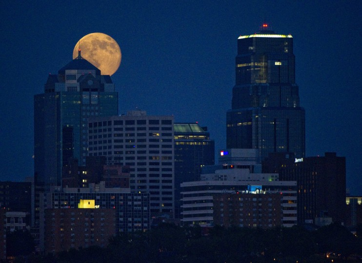 The Supermoon rises over downtown Kansas City, Missouri July 12, 2014. Occurring when a full moon or new moon coincides with the closest approach the moon makes to the Earth, the Supermoon results in a larger-than-usual appearance of the lunar disk. (Dave Kaup/Reuters)
