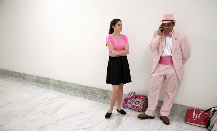 Code Pink anti-war protesters stand in the hallway as they await to attend a House Armed Services Committee hearing on Capitol Hill in Washington. (Kevin Lamarque/Reuters)