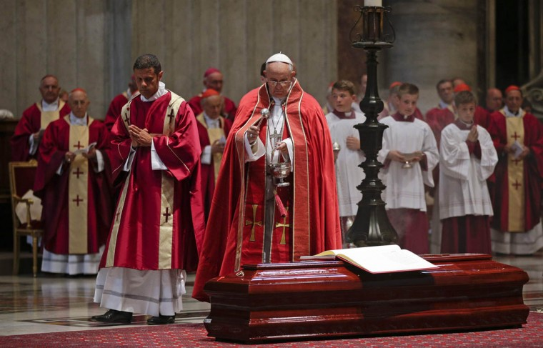 Pope Francis sprinkles holy water over the coffin of Italian cardinal Francesco Marchisano during a funeral service in Saint Peter's Square at the Vatican July 30, 2014. (Max Rossi/Reuters photo)