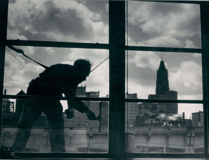April 12, 1957: Spring cleaning time for these window washers. (Robert F. Kniesche)