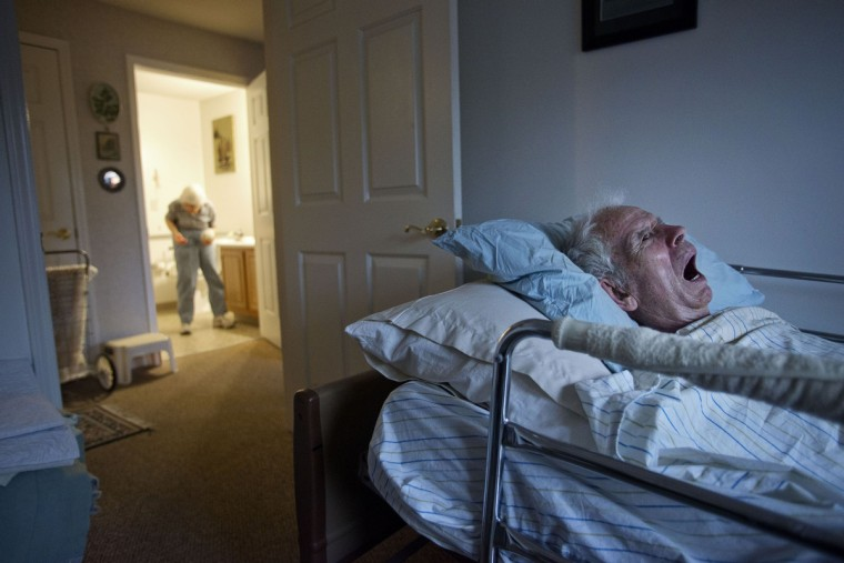 Roger and Eleanor Barnard live in Longview, a residential senior retirement community located in Ithaca, NY. Roger, 86, has suffered from Parkinson's and Alzheimer's since 1992. Roger lies in bed as his wife Eleanor washes clothes in the bathroom. Rachel Woolf/Baltimore Sun