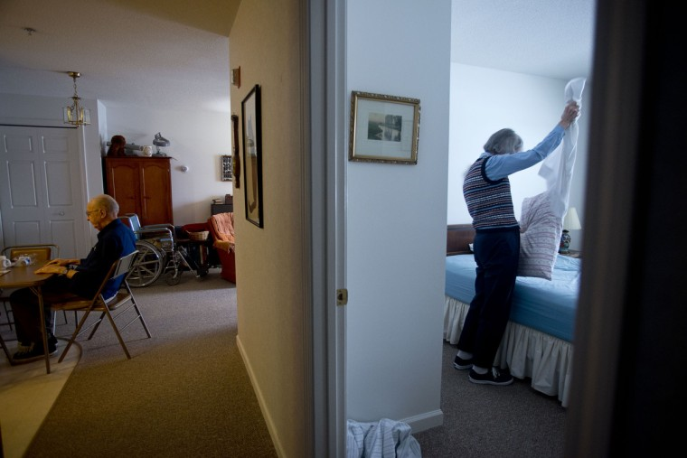 Ted Buckley, left, sits and waits while his wife, Jan Buckley makes her bed in their apartment in Longview, a residential senior retirement community in Ithaca, NY. Ted is 83 and suffering from early stages of dementia. Rachel Woolf/Baltimore Sun