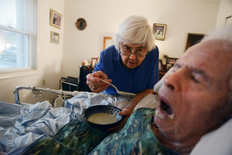 "Roger Barnard has choked before, and to avoid further problems, Eleanor Barnard began pureeing his food and feeding it to him. ""It gives you a good feeling that you're still together, and that he knows that you're there to help him. He feels he hasn't been abandoned,"" Eleanor said. Rachel Woolf/Baltimore Sun"