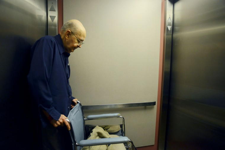 "Ted Buckley waits in the elevator following his lunch to return to his apartment. ""I know what the progression is, I know it will happen. But you can't live that way always thinking about what's going to happen. You have to live day by day,"" his wife Jan Buckley said. Rachel Woolf/Baltimore Sun"