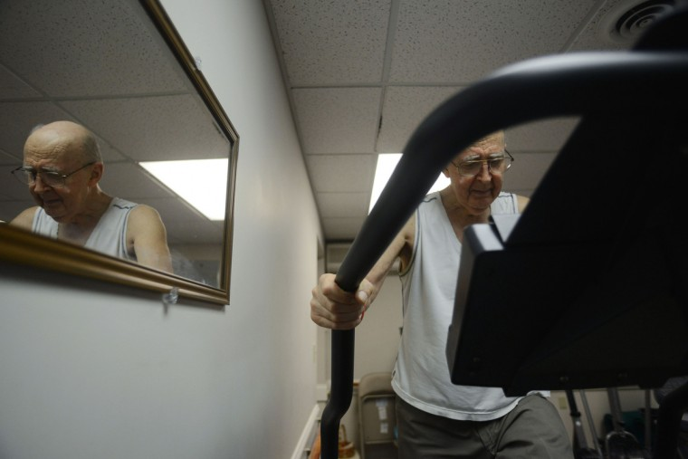 Ted Buckley walks on the treadmill. Ted has a neurological problem that additionally affects his movement. Although, when his legs are doing well, he prefers to exercise as much as possible. Rachel Woolf/Baltimore Sun